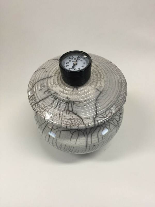 white raku fired pot with lid with pressure gauge for handle